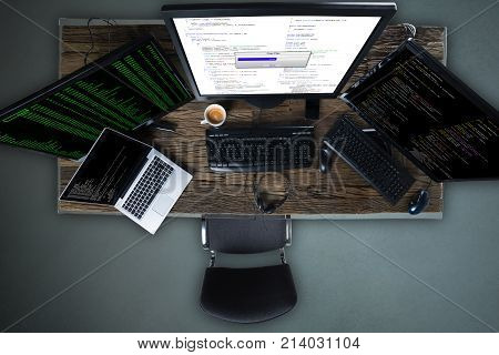 High Angle View Of Multiple Computer Screen Showing Progress Bar Of Copying File On Desk