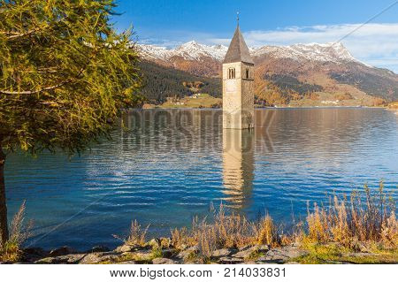 Submerged bell tower in lake resia Italian eastern alps