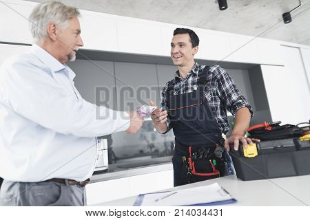 A plumber man communicates with a client who pays for the work done. The old man gives the plumber a fee. A black box for tools is next to it.