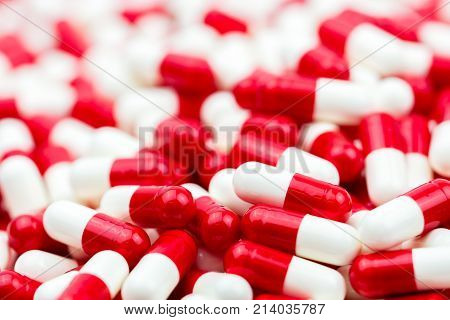 Selective focus of antibiotic capsules pills on blur background with copy space. Drug resistance concept. Antibiotics drug use with reasonable and global healthcare concept.