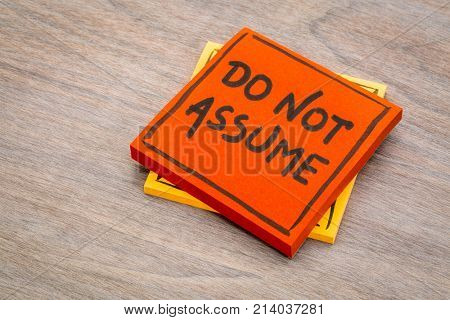 Do not assume advice or reminder handwriting on a sticky note against grained wood