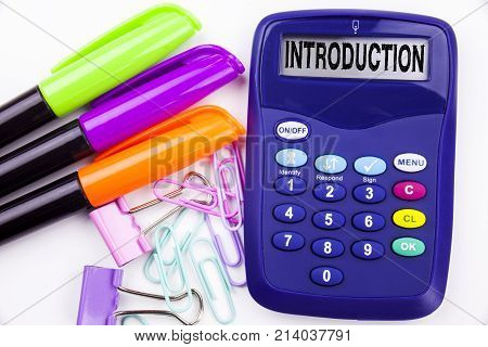 Introduction Text In The Office With Surroundings Such As Marker, Pen Writing On Calculator. Busines