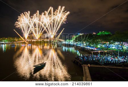 Kuching sarawak,malaysia november11 2017 : a awesome fireworks show in conjunction with the inauguration of a new bridge facing the Sarawak state assembly.Happy New Year. concept Celebration.