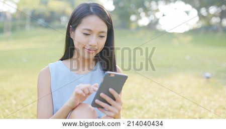 Woman using mobile phone to send sms