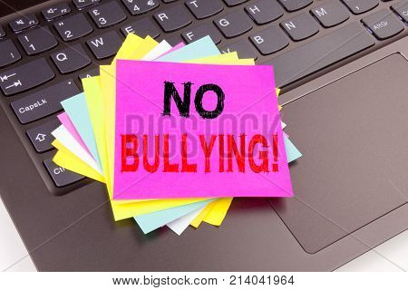 Writing Text Showing No Bullying Made In The Office With Surroundings Such As Laptop, Marker, Pen. B