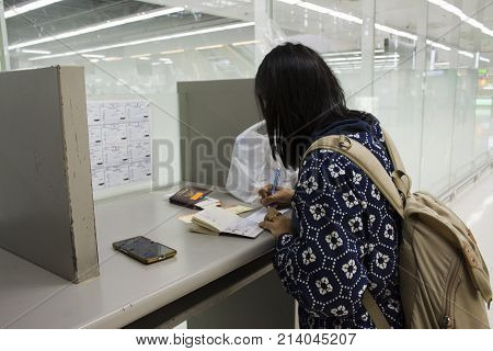 Asia Traveler Thai Women Writing Departure Card And Arrival Card At Suvarnabhumi International Airpo