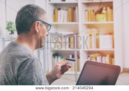 Hearing impaired man paying with credit card