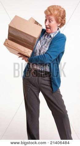 Senior woman holding a lot of parcels