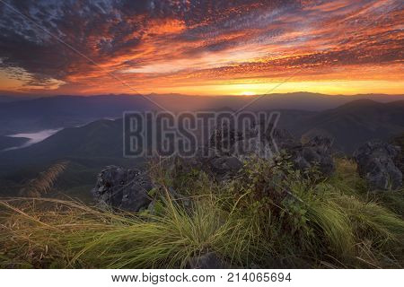 Beautiful scenery during time the sunrise view on the top of Doi Pha Phung at Nan province in Thailand is a very popular for photographers and tourists. Attractions and natural Concept