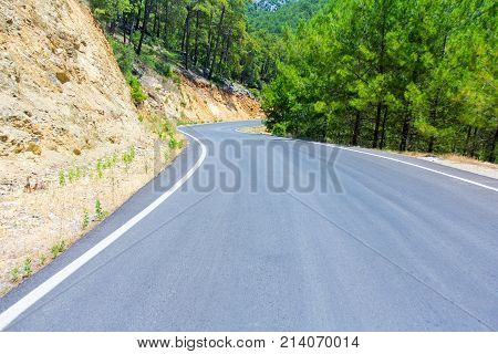Road Trip Concept - Curved Asphalt Road In Forest