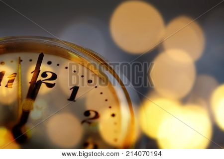 new Year's at midnight - clock at twelve o'clock with holiday lights