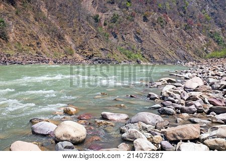 View on the river Ganges near Laxman Jhula in India poster