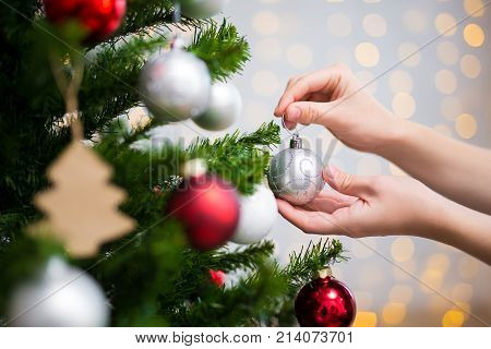 Christmas Background - Close Up Of Woman Decorating Christmas Tree