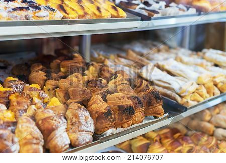 Portuguese traditional pastries. Buns with custard in shop-window.