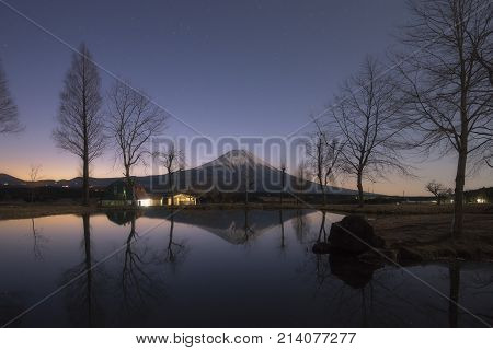Mt.Fuji in early morning with reflection on pond at Fumotoppara campground