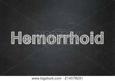 Healthcare concept: text Hemorrhoid on Black chalkboard background