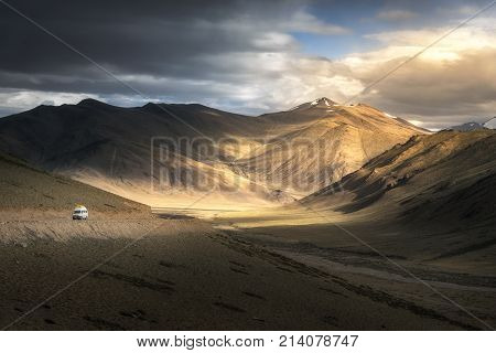 View Of Leh Manali Highway Road On Himalayan Range Mountain With Dramatic Light Shade On The Road. L