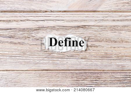 DEFINE of the word on paper. concept. Words of DEFINE on a wooden background.