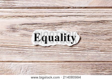 Equality of the word on paper. concept. Words of Equality on a wooden background.