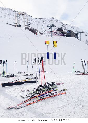 Skis at winter ski resort Courmayeur, Italian Alps. Mountains, chair lifts and cable car station