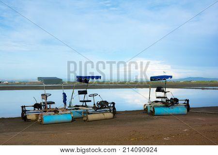 Sea salt farm with Three roller cars at Banlam Phetchaburi Thailand.