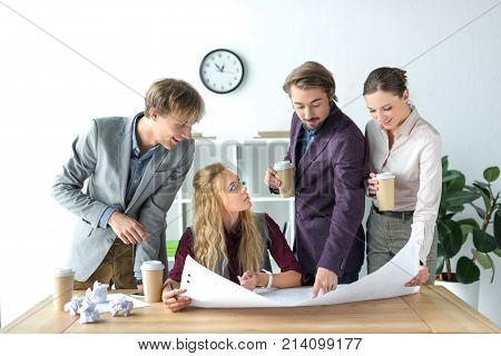 Business Partners Looking At Flipchart Paper
