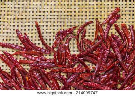 Dried Chillies On Bamboo Background