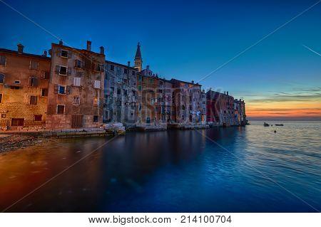 Coastal town of Rovinj, Istria, Croatia in sunset. Rovin beauty antiq city at the warm sea