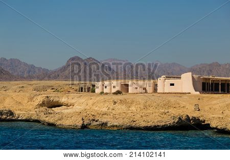 Colorful landscape: Sinai desert on the coast of the Red Sea against the backdrop of mountains and a bright blue sky. Ras Muhammad National Park Egypt. Tourist attraction
