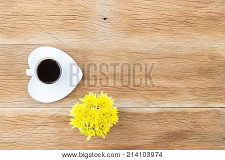Coffee Cup And Heart Shaped Saucer On Wooden Background