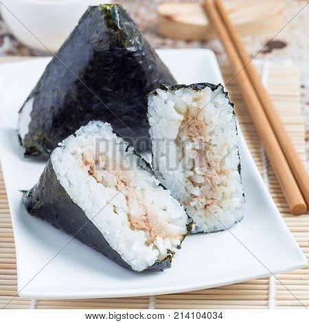 Korean triangle kimbap Samgak made with nori rice and tuna fish similar to Japanese rice ball onigiri square format