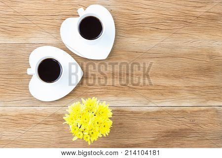 Coffee Cups And Heart Shaped Saucers On Wooden Background