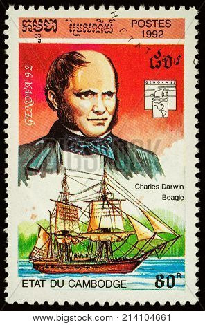 Moscow Russia - November 16 2017: A stamp printed in Cambodia shows English scientist Charles Darwin and ship