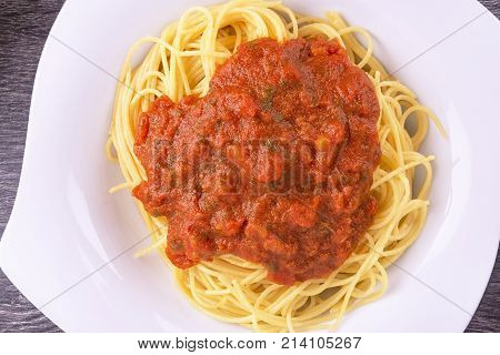 Plate of cooked spaghetti pasta. Top view.
