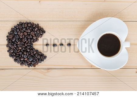 Coffee Beans Shaped To Fish Head Eating Coffee Bean And Coffee Cup