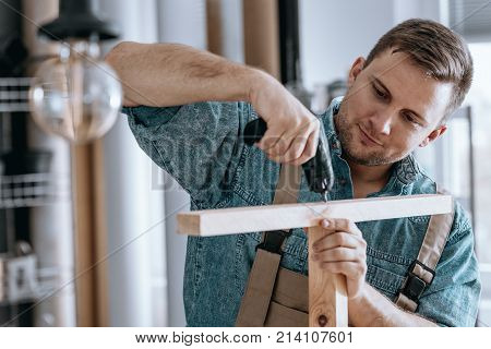 Satisfied Carpenter Tightening Screws