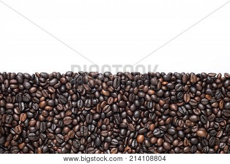Coffee beans on white background in half frame