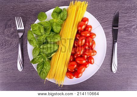 Italian cuisine ingredients on a white plate top view.