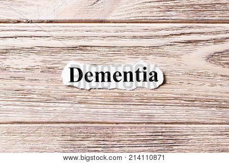 Dementia of the word on paper. concept. Words of Dementia on a wooden background.