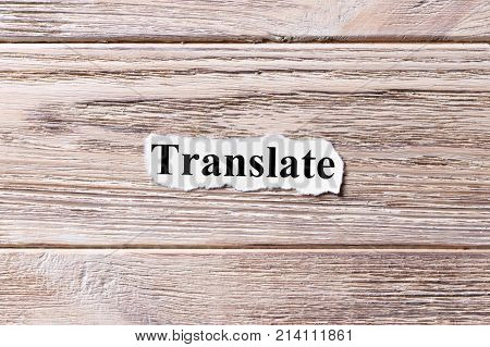 Translate word on paper. concept. Word Translate on a wooden background.