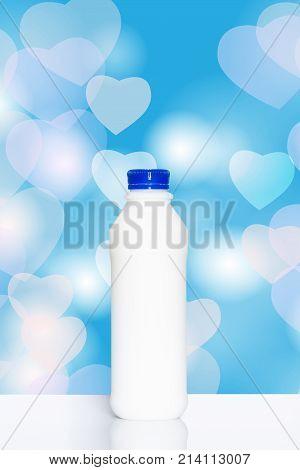 Bottle Of Milk On Colorful Heart Shaped Bokeh Background.,