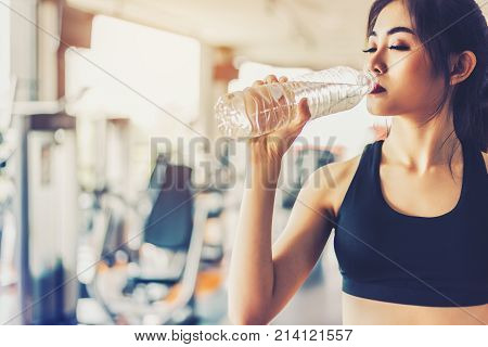 Asian Woman Drinking Pure Drinking Water For Freshness After Workout Or Exercise Training In Fitness