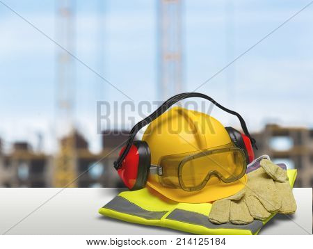 Gloves helmet safety safe blue background equipment
