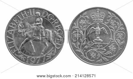 1977 Silver Jubilee Crown coin celebrating Queen Elizabeth II's silver jubilee. Equestrian Portrait Her Majesty seated on horseback. Coronation regalia with ampulla and anointing spoon on reverse.