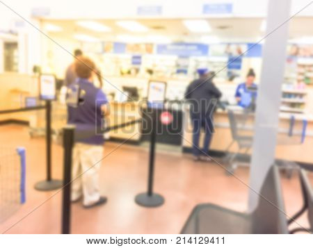 Blurred People At Pharmacy Pickup Area At Retail Store In Usa.