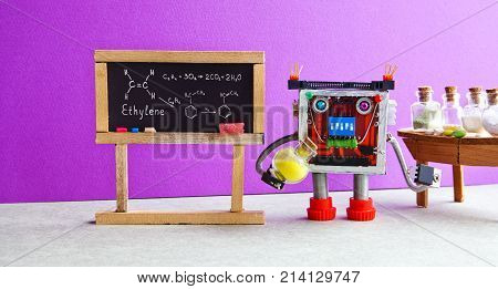 Chemistry lesson college laboratory. Robot professor with yellow chemical reagent bottle explains molecular formula ethylene. Classroom interior with handwritten formula black chalkboard