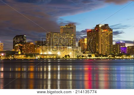 NEW ORLEANS - JUN. 2, 2017: New Orleans skyline at twilight on Mississippi River in New Orleans, Louisiana, USA.