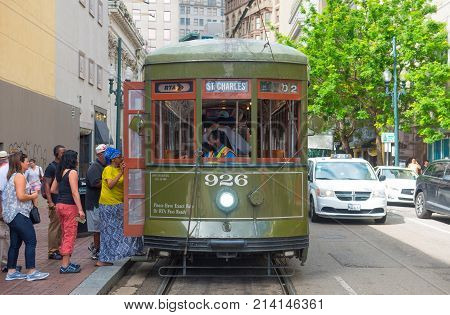 NEW ORLEANS - JUN. 2, 2017: RTA antique Streetcar St. Charles Line Route 12 on Canal Street in downtown New Orleans, Louisiana, USA. This line is registered as a US National Historic Places.