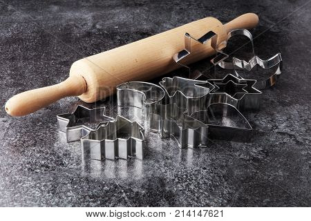 baking and kitchen tool utensil rolling pin and christmas cutters.