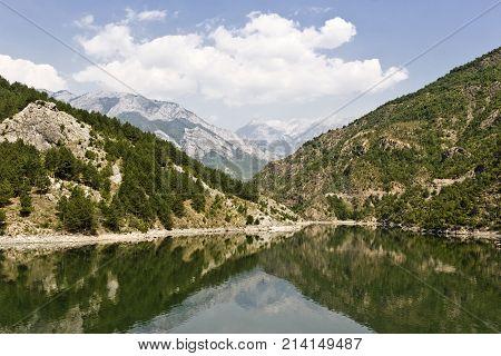 Beautiful reflection on the Komani lake in Albania